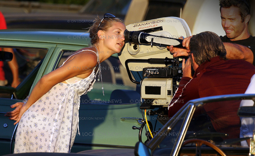 EXCLUSIVE Photo July 26, 2007 Pasadena, CA. Kate Hudson directs a short film for Glamour Reel Moments which is based on real life stories submitted to the American magazine Glamour. She was given $500,000 and 3 days to complete the film. Besides casting Chevy Chase and her dad Kurt Russel, Kate Hudson also cast Dax Shepard whom she has been dating. Dax was very supportive of Kate on the set.. Also on the set Kurt Russel showed Kate how to better operate the camera. Kate Hudson took her job serious and was well respected by her crew.