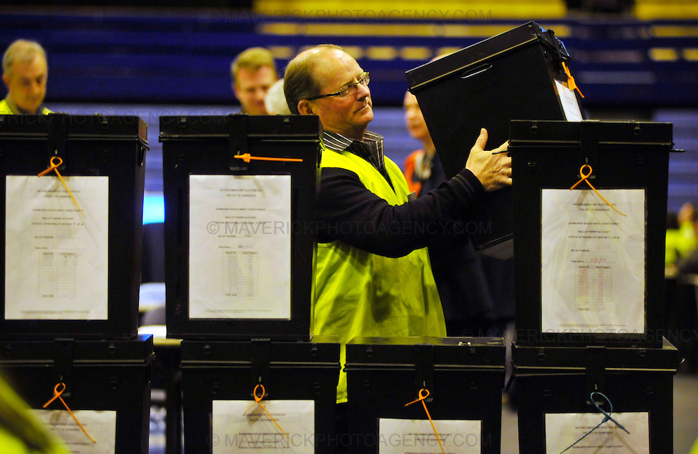 EDINBURGH, UK - 6th MAY 2010: Staff prepare to open ballot boxes at Meadowbank Stadium for the main ballot paper count in Edinburgh, Scotland. In one of the most important elections in recent years the outcome of the UK general election will soon be known after polling stations across the country closed. (Photograph: Callum Bennetts/MAVERICK)