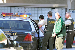 H:\EDITORIAL\Photos\12 December 2009\JH 12-3-09Lost Hills Sheriff Station officers Robert de Santos, right, and xx, second from right, assist in containing a bank robbery suspect in the parking lot of the xx Apartments in Agoura Hills on Monday.
