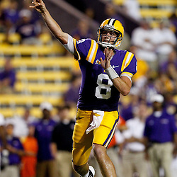 September 10, 2011; Baton Rouge, LA, USA;  LSU Tigers quarterback Zach Mettenberger (8) throws a touchdown against the Northwestern State Demons during the fourth quarter at Tiger Stadium. LSU defeat Northwestern State 49-3. Mandatory Credit: Derick E. Hingle