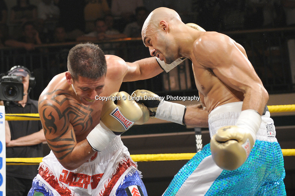 Kris Agyei-Dua (turquoise shorts) defeats Jeff Thomas in Quater Final Three of Prizefighter  - The Light Middleweights II. York Hall, Bethnal Green, London, UK. 15th September 2011. Photo credit: © Leigh Dawney.