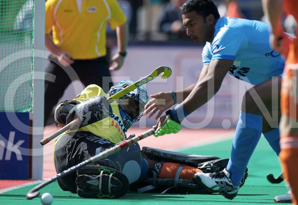 ROTTERDAM - Hock World League Semi Final Men<br /> Netherlands v India<br /> foto: PARATTU RAVEENDRAN Sreejesh (GK) save<br /> FFU PRESS AGENCY COPYRIGHT FRANK UIJLENBROEK