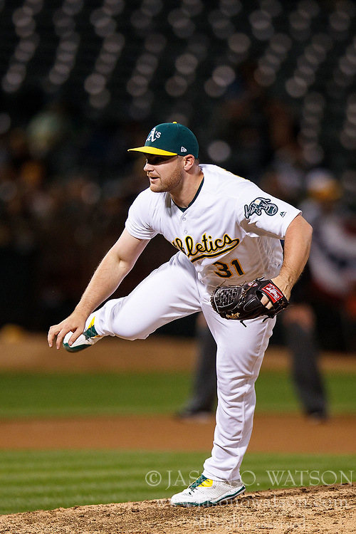 OAKLAND, CA - APRIL 04:  Liam Hendriks #31 of the Oakland Athletics pitches against the Los Angeles Angels of Anaheim during the seventh inning at the Oakland Coliseum on April 4, 2017 in Oakland, California. The Los Angeles Angels of Anaheim defeated the Oakland Athletics 7-6. (Photo by Jason O. Watson/Getty Images) *** Local Caption *** Liam Hendriks