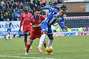 Wigan Athletic Defender, Reece Wabara in in the middle of the action  again during the Sky Bet League 1 match between Wigan Athletic and Oldham Athletic at the DW Stadium, Wigan, England on 13 February 2016. Photo by Mark Pollitt.