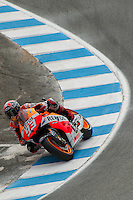 Repsol Honda Moto GP racer, Marc Marquez, rides out of the cork screw turn at Mazda Raceway - Laguna Seca, CA.