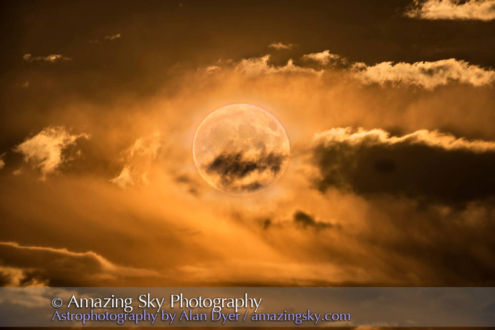 "The well-publicized - if not overly publicized! - supermoon (a perigee Full Moon) of November 14, 2016, seen here about 3 degrees above the horizon, rising out of low clouds. The yellow colour is natural, and illuminated the field with a golden glow. However, this is a stack of 4 exposures, from long to short, to create an ""HDR"" style stack as the longest exposure needed for the clouds blew out the bright Moon. A short exposure was needed for the Moon itself. I took 4 exposures at about 2 stop increments from 1.5 seconds to 1/15 second and blended them not with HDR software but with luminosity masks using the ADP Panel+ scripts from Aaron Dowling Photography. All exposures with the Explore Scientific FCD100 apo refractor at f/7 and Nikon D750 at ISO 100."