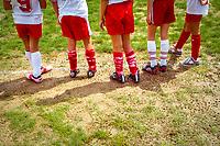 Soccer feet on sideline