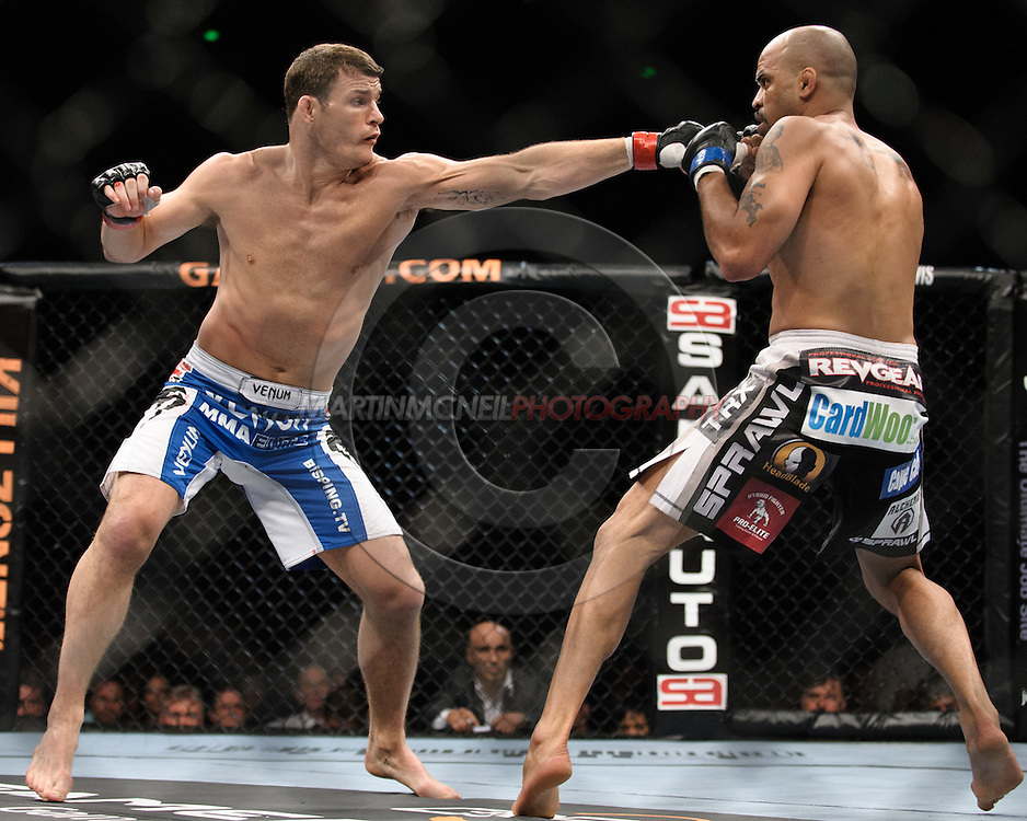 "SYDNEY, AUSTRALIA, FEBRUARY 27, 2011: Michael Bisping (left) throws a left jab at Jorge Rivera during ""UFC 127: Penn vs. Fitch"" inside Acer Arena in Sydney, Australia on February 27, 2011."