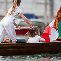 VENICE, ITALY - SEPTEMBER 05:  Children in a Venetian boat take  in the Historic Regata on September 5, 2010 in Venice, Italy. The Historic Regata is the most exciting rowing race on the Gran Canal for the locals and one of the most spectacular. ***Agreed Fee's Apply To All Image Use***.Marco Secchi /Xianpix. tel +44 (0) 207 1939846. e-mail ms@msecchi.com .www.marcosecchi.com