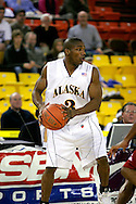 24 November 2005:  University of Alaska Anchorage senior guard Kemmy Burgess looks for a pass in the UAA Seawolves 60-65 loss to the South Carolina Gamecock's in the first round of the Great Alaska Shootout at the Sullivan Arena in Anchorage Alaska.