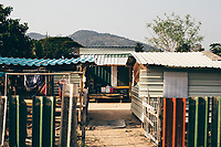A small makeshift housing complex where Sompon Samrong and his two boys live and train in Rayong, Thailand.