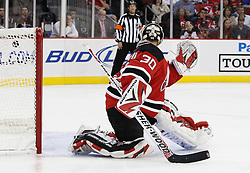 Oct 3, 2009; Newark, NJ, USA; New Jersey Devils goalie Martin Brodeur (30) has a shot from Philadelphia Flyers center Darroll Powe (36) go past him during the third period at the Prudential Center. The Flyers defeated the Devils 5-2.