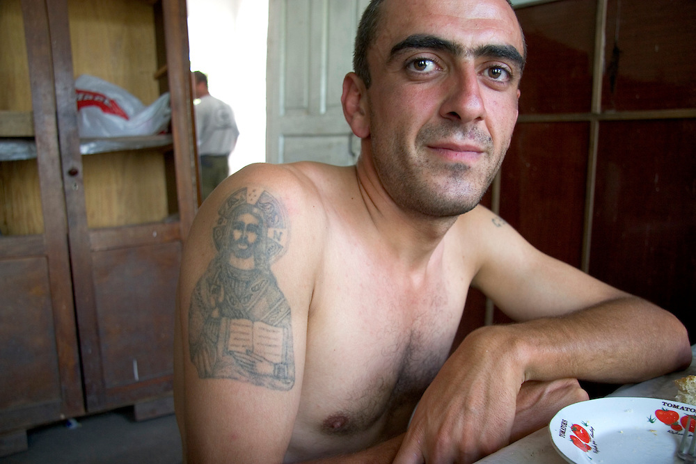 A deminer for the Halo Trust relaxes after a meal at a guesthouse for Halo deminers in the Martuni region of Nagorno-Karabakh.