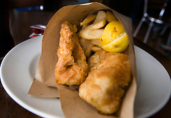 Fish and chips served in a paper cone, Fish Frenzy, Elizabeth Street Pier, Hobart, Tasmania, Australia