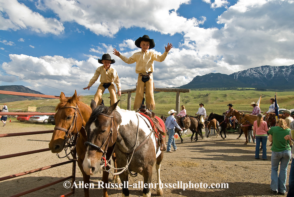 Young cowboys showing off on horses, Gardiner, Montana Rodeo