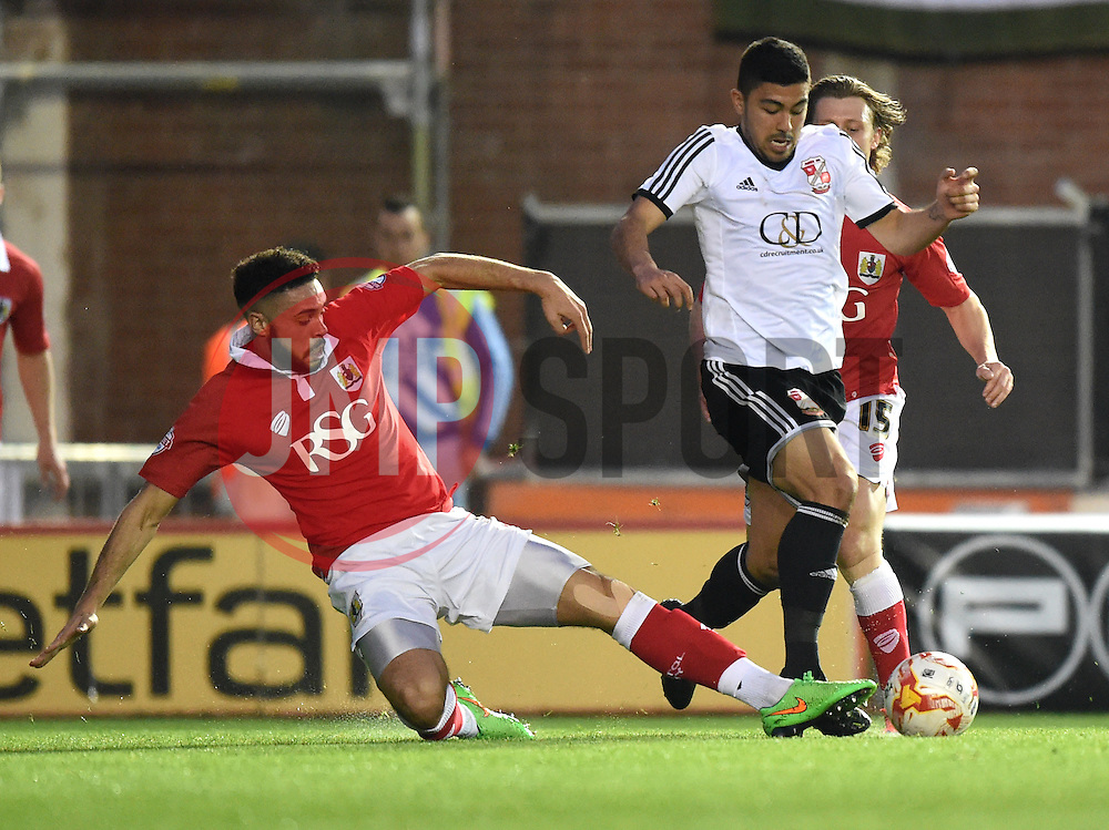 Bristol City's Derrick Williams tackles Swindon Town's Massimo Luongo - Photo mandatory by-line: Paul Knight/JMP - Mobile: 07966 386802 - 07/04/2015 - SPORT - Football - Bristol - Ashton Gate Stadium - Bristol City v Swindon Town - Sky Bet League One