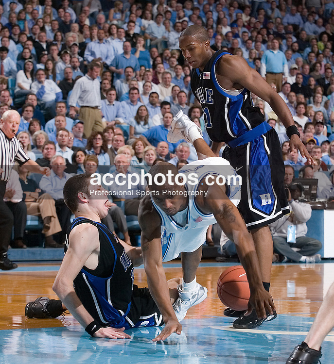 07 February 2006: Junior forward Reyshawn Terry (3) tangles with freshmen forward Josh McRoberts (2) and (standing) sophomore DeMarcus Nelson (21) during a Duke Blue Devils 87-83 victory over the North Carolina Tarheels, in the Dean Smith Center in Chapel Hill, NC.