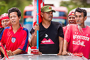 08 MAY 2013 - BANGKOK, THAILAND:   Red Shirts stand in the back of pickup truck during a motorcade to the Thai parliament building. A splinter group of the Red Shirts, Thai supporters of exiled Prime Minister Thaksin Shinawatra, have besieged the Thai Constitutional Court for the last three weeks calling for the resignation of the justices, who have indicated they might oppose a proposed constitutional reform which would grant amnesty to people convicted of political crimes since 2007. This would probably include Thaksin. The justices have refused to step down. Wednesday the protesters moved their protest to the Thai Parliament, which is largely powerless to intervene. PHOTO BY JACK KURTZ