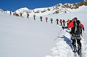 Long line of backcountry skiers in Austria's Otztal Alps.