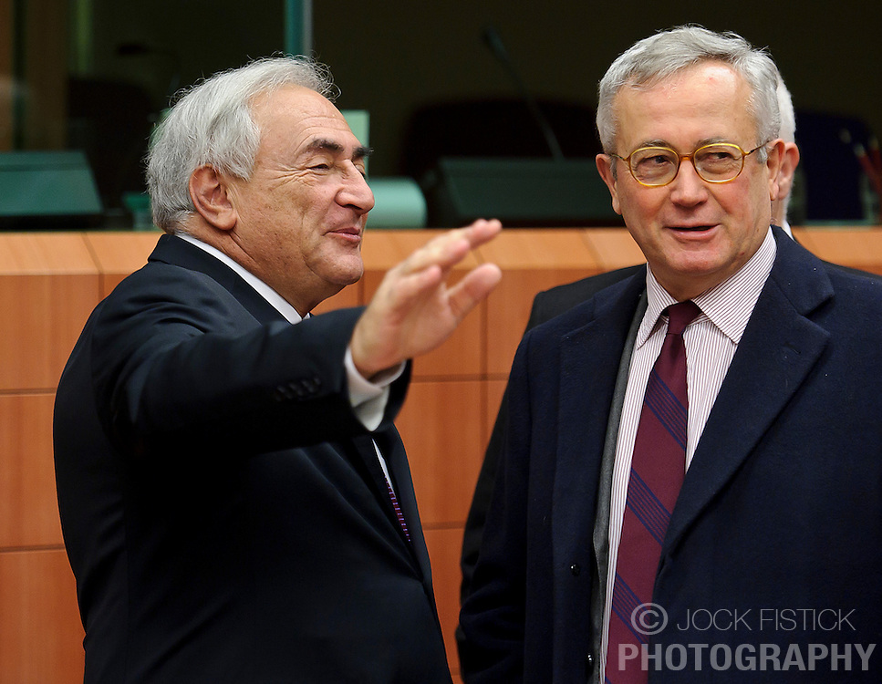 Dominique Strauss-Kahn, managing director of the IMF, left, speaks with Giulio Tremonti, Italy's finance minister, during a meeting of the Eurogroup finance ministers at the EU Council headquarters in Brussels, Monday, Dec. 6, 2010. (Photo © Jock Fistick)
