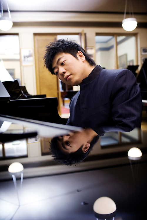 UK. London. Lang Lang, internationally renowned concert pianist who performed at the Beijing olympics photographed in London before playing at the Royal Albert Hall for the Proms. Photographed at the Steinway studios in London.