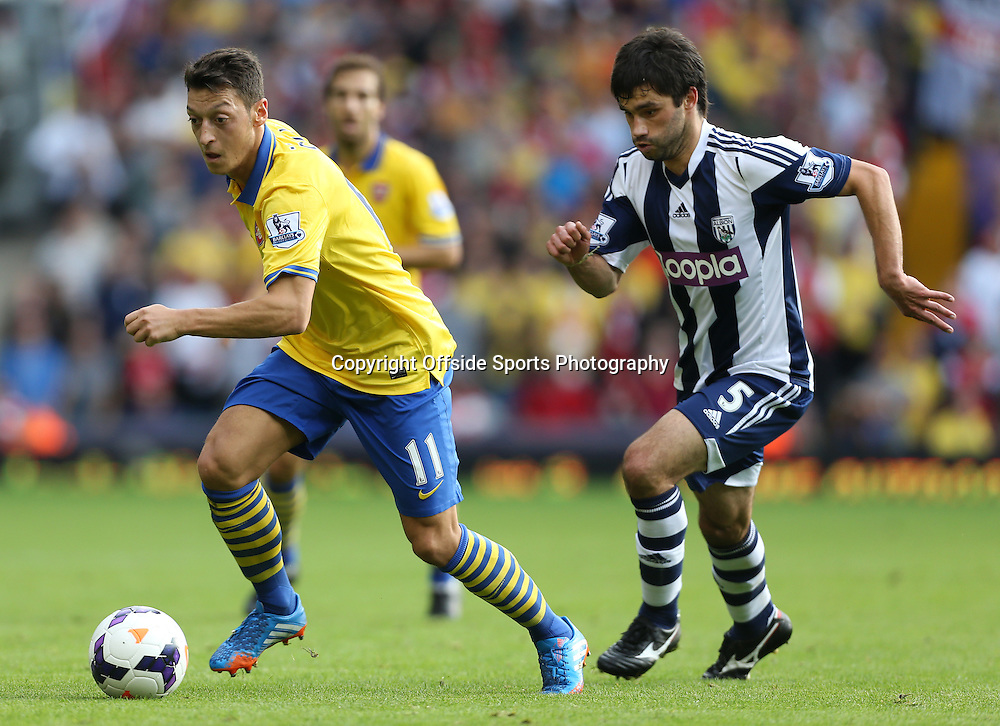 6th October 2013 - Barclays Premier League - West Bromwich Albion v Arsenal - Mesut Ozil of Arsenal gets away from Claudio Yacob of West Brom - Photo: Simon Stacpoole / Offside.