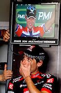 MONTARGIS 20100807. VG fikk ekslusiv tilgang bak podiet og fulgte Thor Hushovd fra mållinja og gjennom uttdelingen av den grønne trøya. Dagens mest aggresive rytter Jose Ivan Gutierrez venter på bakrommet på sin premie mens Hushovd får sin trøye på podiet..Foto: Daniel Sannum Lauten/VG