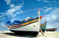 Colorful boats on the beach in Algarve, Portugal