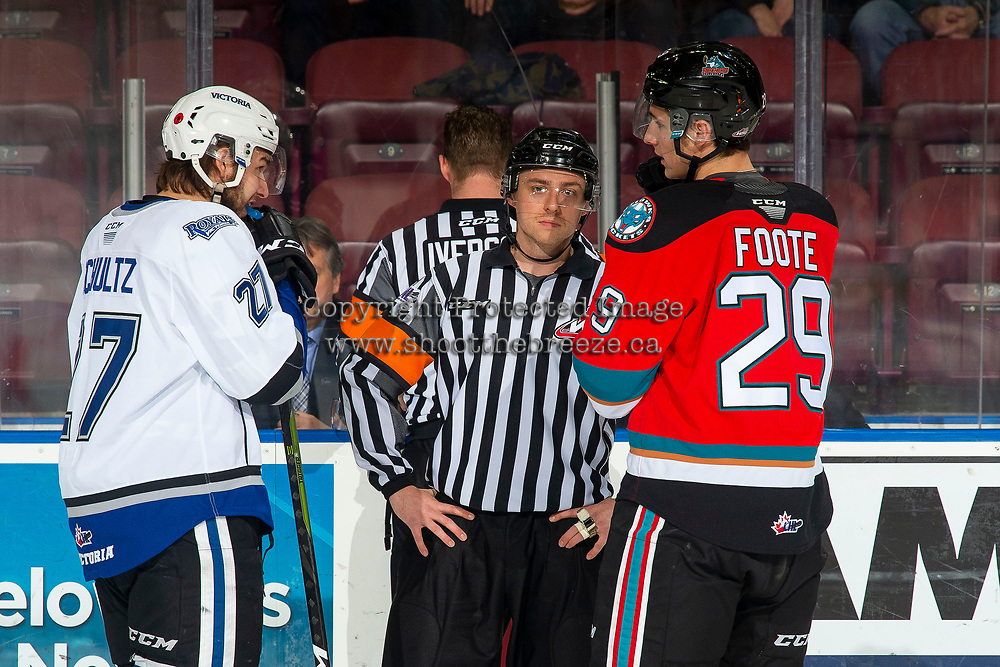 KELOWNA, BC - NOVEMBER 6: Team captains Phillip Schultz #27 of the Victoria Royals and Nolan Foote #29 of the Kelowna Rockets stand with referee Mark Pearce as referee Brett Iverson awaits a decision from video goal judges at Prospera Place on November 6, 2019 in Kelowna, Canada. (Photo by Marissa Baecker/Shoot the Breeze)