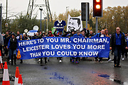 The Leicester City Supporters Club parade arrives outside The King Power Stadium in the rain before the Premier League match between Leicester City and Burnley at the King Power Stadium, Leicester, England on 10 November 2018.