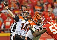 Quarterback Andy Dalton #14 of the Cincinnati Bengals throws a pass during the second half against the Kansas City Chiefs at Arrowhead Stadium in Kansas City, Missouri.