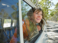 Young Woman Leaning out of Van Window half length