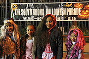 Oct. 25, 2013 - Bronx, NY. (L-R) Elianni, 9, Mia, 7, Katherine, 10, and Elyn, 7, dressed up as characters from Monster High, a princess and Little Red Riding Hood for the 28th Annual South Bronx Halloween Parade in Hunts Point. 10/25/2013 Photo by Nicholas Wells / CUNY Photo Wire