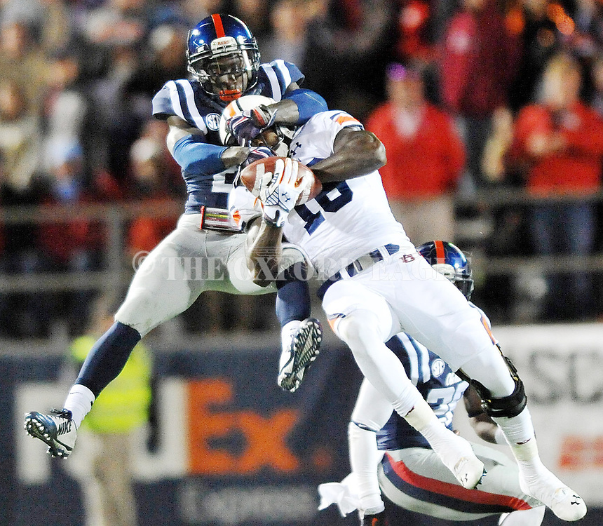 Auburn Tigers' wide receiver Sammie Coates (18) makes a catch as Mississippi defensive back Senquez Golson (21) defends at Vaught-Hemingway Stadium in Oxford, Miss. on Saturday, November 1, 2014. Auburn won 35-31.(AP Photo/Oxford Eagle, Bruce Newman)