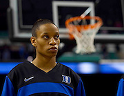 Duke Senior Point Guard Jasmine Thomas concentrates during the playing of the National Anthem prior to Duke's 81 - 66 victory over North Carolina in the Championship Game of the 2011 ACC Women's Basketball Tournament held at the Greensboro Coliseum in Greensboro, North Carolina.  Thomas finished with 21 points and was selected as the Tournament MVP.  (Photo by Mark W. Sutton)