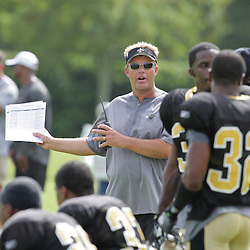 31 July 2009: Saints defensive coordinator, Gregg Williams talks to players on the field during the opening day of New Orleans Saints training camp held at the team's practice facility in Metairie, Louisiana.