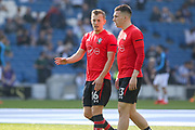 Southampton midfielder James Ward-Prowse (16) and Southampton midfielder Pierre-Emile Hojbjerg (23) warm up discussion during the Premier League match between Brighton and Hove Albion and Southampton at the American Express Community Stadium, Brighton and Hove, England on 30 March 2019.