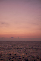 Pastel colored sky and clouds over the Pacific Ocean at dawn.  Image 9 of 21  for a panorama taken with a Fuji X-T1 camera and 35 mm f/1.4 lens  (ISO 400, 35 mm, f/2.8, 1/30 sec). Raw images processed with Capture One Pro and stitched together with AutoPano Giga Pro.