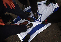 COEUR D ALENE, ID - JULY 17:  Members of the Aryan Nation step of an Israeli flag during the World Congress Parade held in Coeur d'Alene, Idaho, on Saturday, July 17, 2004. About 40 supporters and members marched in downtown Coeur d'Alene for the Aryan World Congress.