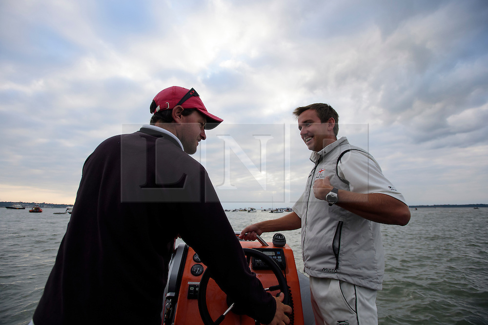 © Licensed to London News Pictures. 18/09/2016. Portsmouth, UK. To team member on a boat making their way to the match. Teams take part in the  Bramble Bank Cricket Match in the middle of The Solent strait on September 18, 2016. The annual cricket match between the Royal Southern Yacht Club and The Island Sailing Club, takes place on a sandbank which appears for 30 minutes at lowest tide. The game lasts until the tide returns. Photo credit: Ben Cawthra/LNP