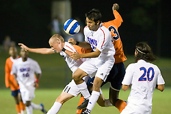 Southern Methodist Mustangs defender/midfielder Daniel Lopez (7) wins a header from Virginia Cavaliers midfielder Tony Tchani (23).  The #18 ranked Virginia Cavaliers fell to the #14 ranked Southern Methodist Mustangs 3-1 in NCAA men's soccer at Klockner Stadium on the Grounds of the University of Virginia in Charlottesville, VA on August 31, 2008.