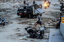 October 2, 2018 - Palu, Central Sulawesi, Indonesia - A car that was destroyed in Palu, after a magnitude 7.5 earthquake and tsunami hit the area on September 28. The Indonesian government said the death toll on the island of Sulawesi had risen to 1,234 people. The quake caused thousands of homes to collapse, along with hospitals, hotels and shopping centers. Emergency services fear that the death toll could rise into the thousands as rescue teams made contact with the nearby cities of Donggala and Mamuju and strong aftershocks continue to rock the city. (Credit Image: © Ivan Damanik/ZUMA Wire)