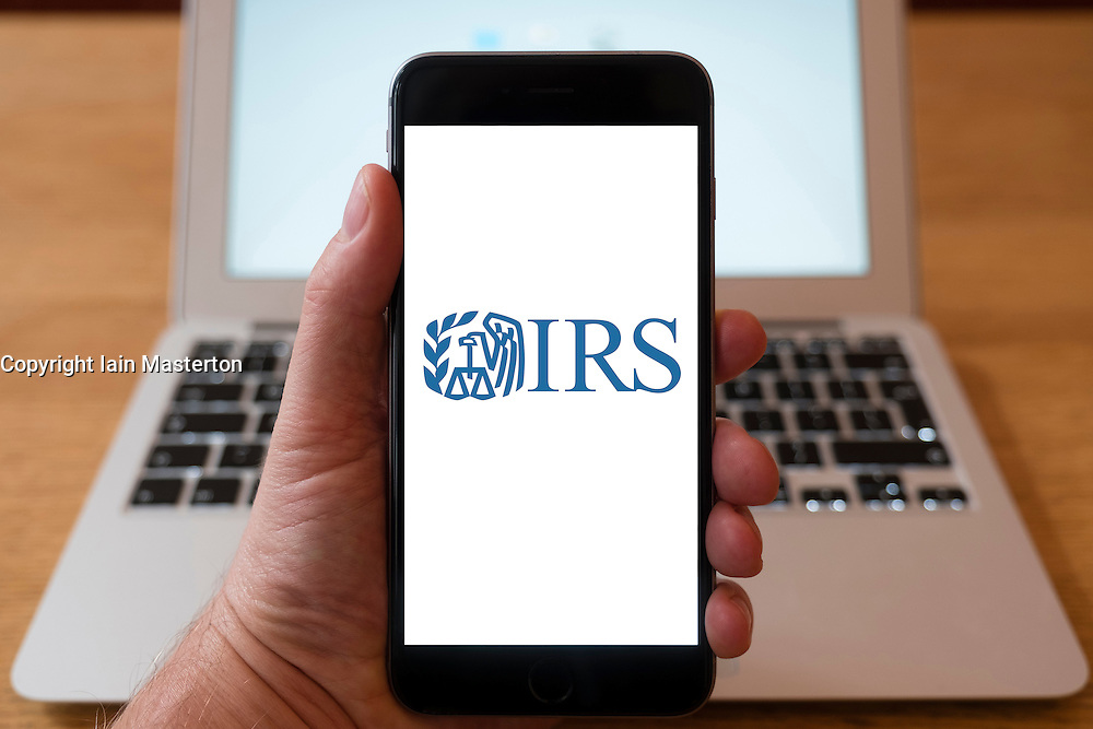Using iPhone smart phone to display website logo of IRS , Inland Revenue Service of the United States