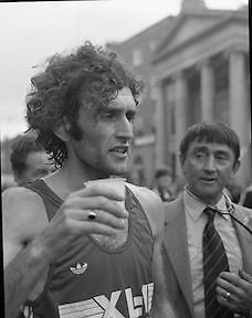 Finish of Dublin City Marathon .25/10/1982  Radio 2, Dublin City Marathon..1982.25.10.1982.10.25.1982.25th October 1982..The Radio 2 sponsored Dublin City Marathon finish at St Stephens Green Dublin..The overall winners were:Men, Gerry Kiernan,Listowel, Kerry. Women, Debbie Mueller,U.S.A. and the first wheelchair competitor Michael O'Rourke.Gerry Kiernan has a reviving drink as a race doctor looks on.