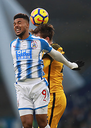 Huddersfield Town's Elias Kachunga (left) and Brighton & Hove Albion's Davy Propper battle for the ball during the Premier League match at the John Smith's Stadium, Huddersfield.