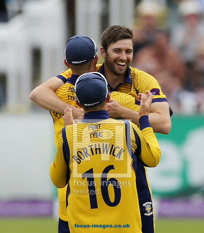 Mark Wood (smiling) of Durham CCC celebrates the wicket of Alex Lees (not shown) of Yorkshire Vikings during the Royal London One Day Cup match at Emirates Riverside, Chester-le-Street<br /> Picture by Simon Moore/Focus Images Ltd 07807 671782<br /> 31/07/2016