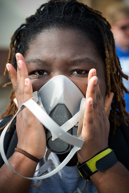 A volunteer checks the seal on a respirator. College students, faculty and staff members from Gettysburg (PA) College volunteer a week of their spring break gutting flood ravaged homes in Saint Bernard Parrish near New Orleans.