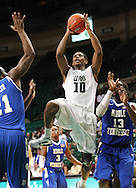 Dec 07, 2011; Birmingham, AL, USA; UAB Blazers guard Jekore Tyler (10) shoots over Middle Tennessee Blue Raiders defenders at  Bartow Arena. The Blazers defeated the Blue Raiders 66-56 Mandatory Credit: Marvin Gentry-
