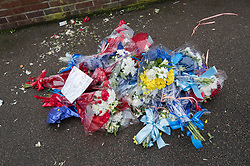 © Licensed to London News Pictures. 11/04/2018. London, UK. The remains of floral tributes lie on the ground after a man who gave his name as Iain Gordon removed them from near the house of Richard Osborn-Brooks. Henry Vincent was killed as he burgled the home of 78 year old Richard Osborn-Brooks. Mr Osborn-Brooks was arrested for murder but later released without charge. Friends and family of Henry Vincent have had floral tributes they placed near the scene repeatedly torn down by locals. Photo credit: Peter Macdiarmid/LNP