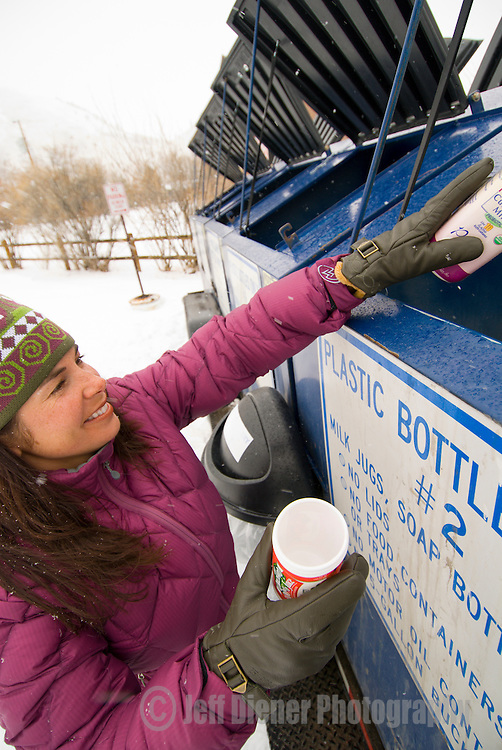 A young woman does the chores at Jackson Community Recycling in Jackson, Wyoming.